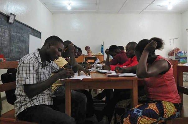 LIBERIA - JUNE 2015: Tubman University nursing graduates study for their licensing exams.