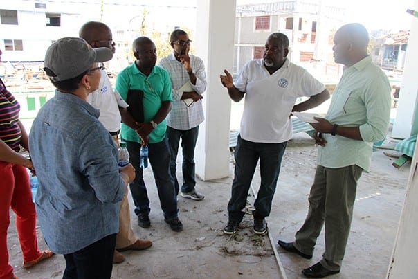PIH's leadership team in Haiti discusses the damage from Hurricane Matthew with Dr.Jean Yves Domercant (center), medical director of the Immaculate Conception Hospital in Les Cayes.