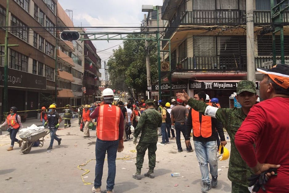 Workers clear rubble in Colonia Doctores, a neighborhood within Mexico City, following a 7.1-magnitude earthquake Tuesday afternoon.