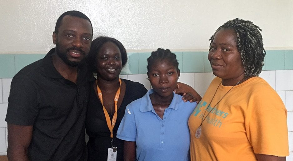 Patient Mable Elliot and members of PIH-Liberia pause for a photo in J.J. Dossen Hospital