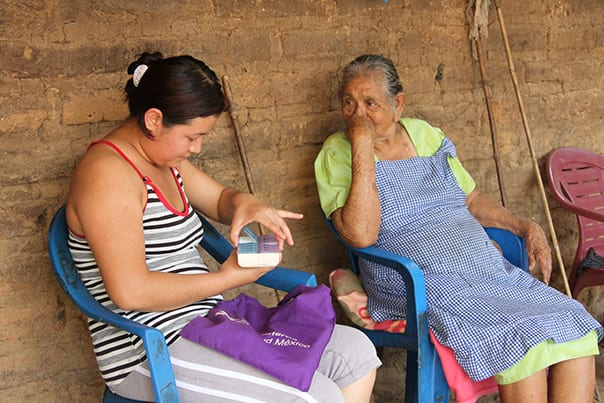 Velasquez visits Maria Roman, who suffers from hypertension and diabetes, to ensure she's taking her medication