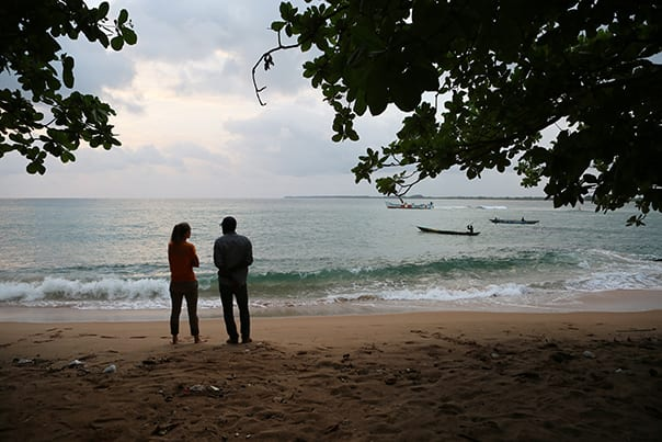 Dr. Ulysse and Dr. Marsh unwind on a beach in Harper, Liberia