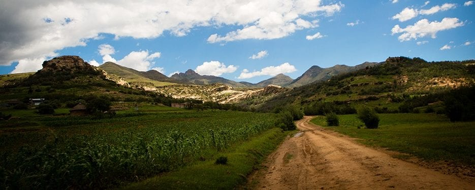 A road stretches toward mountains between the capital city of Maseru and Berea District in Lesotho