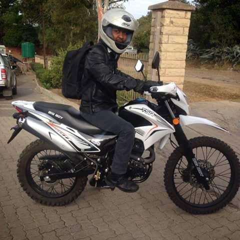 Mojela Masupha on his motorcycle
