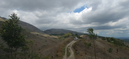 Car on a rough gravel road in rural Haiti