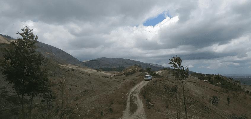 Car on a rough gravel road in rural Haiti