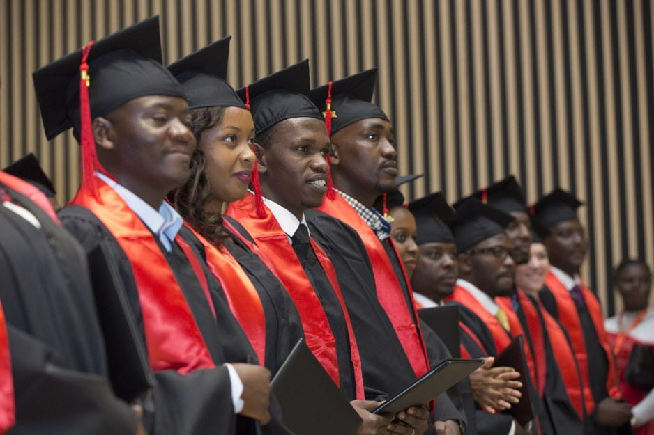 A row of UGHE students stand during the graduation ceremony in May 2017