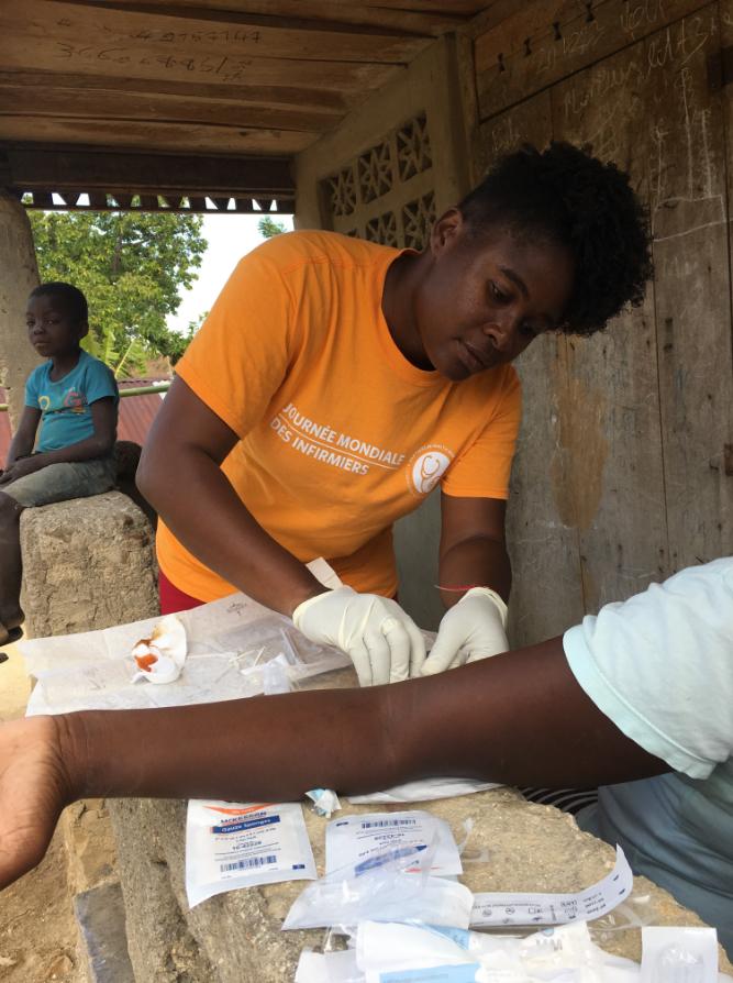 A PIH nurse inserts a Jadelle into a patient's arm