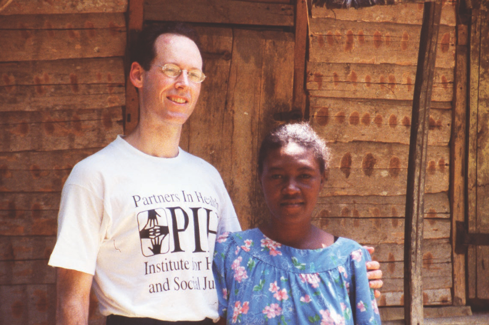 Dr. Paul Farmer stands with a patient