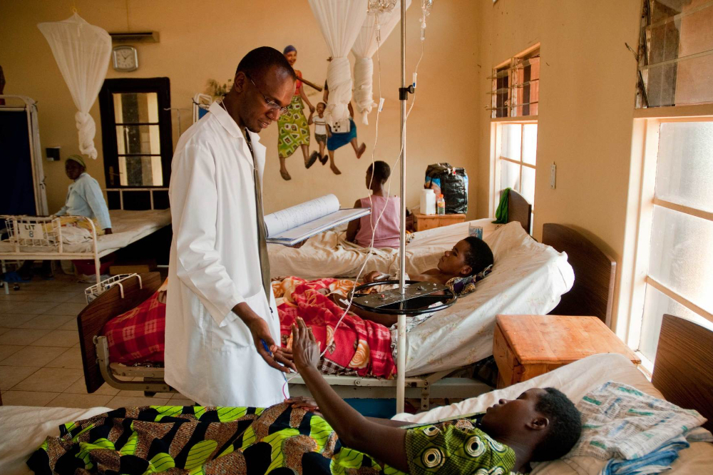 A patient and doctor talk at the Butaro Cancer Center