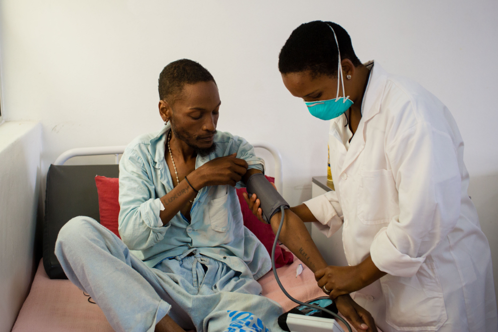 A nurse take the blood pressure of a patient