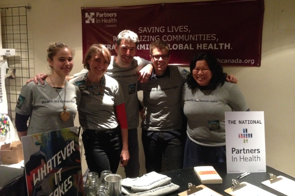 PIH Canada staff and supporters pose together at a booth promoting PIH