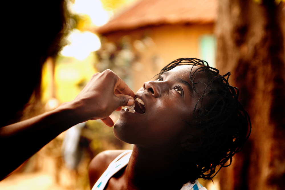 A young women takes the oral cholera vaccine