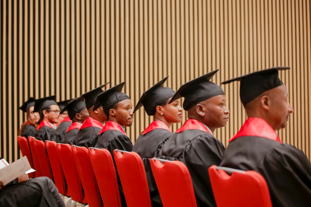 A row of students sit at the UGHE graduation ceremony