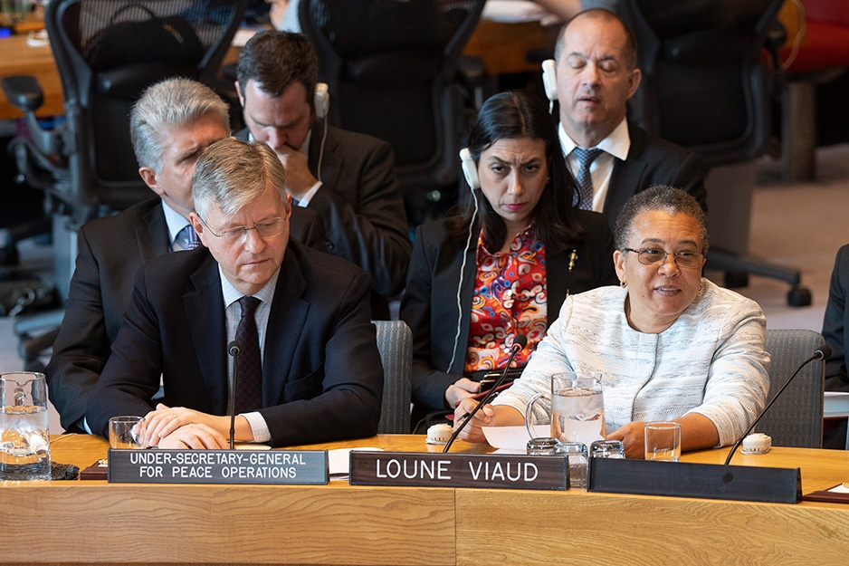 Loune Viaud sits at a table addressing the UN Security Council