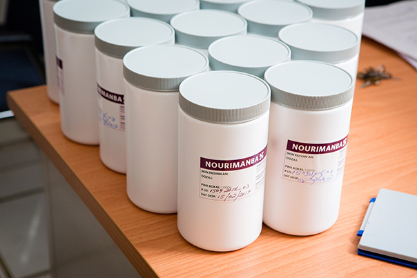 Jars of Nourimanba sit lined up on a table