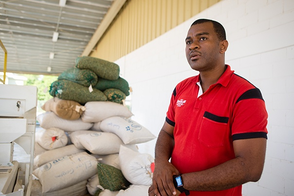 Guy-Thierry Nyam, stands outside the Nourimanba Production Facility
