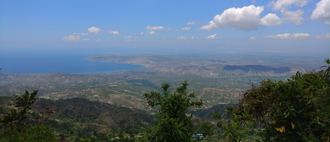 Landscape view of the rolling hill in Haiti leading to the ocean