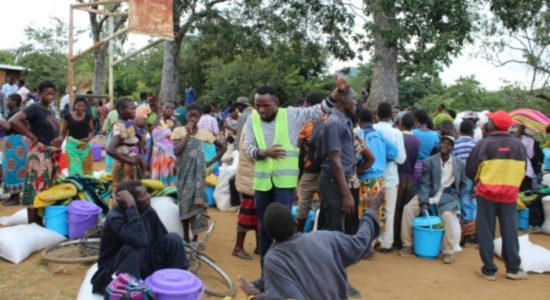 John Living Munthali speaks with community members at a distribution event for victims of the floods