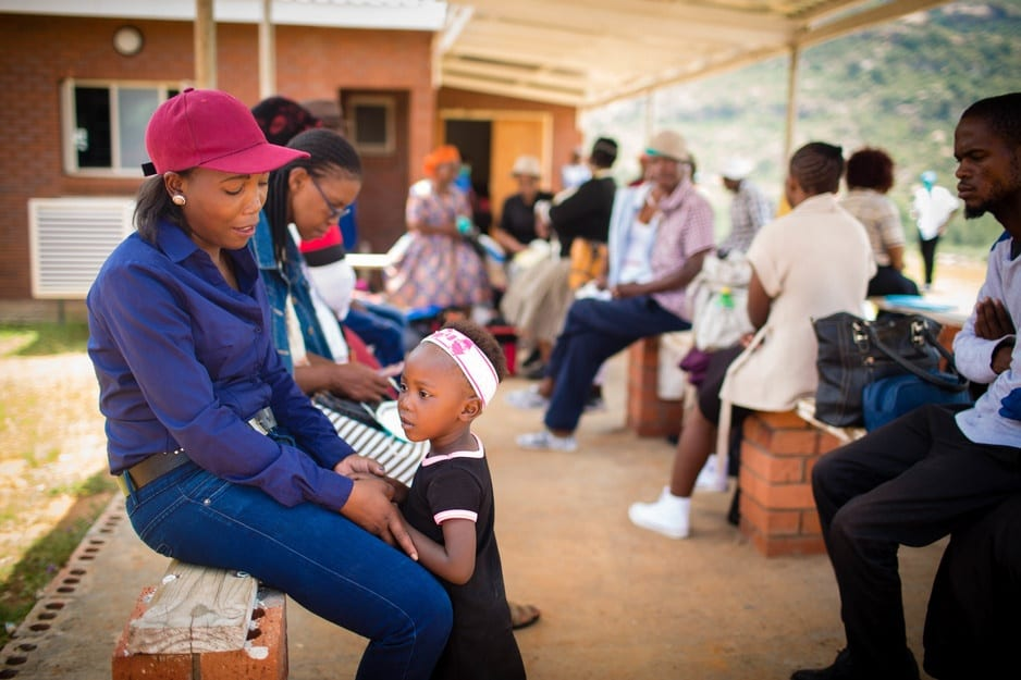Patients sit outside a clinic at Botšabelo Hospital in Lesotho