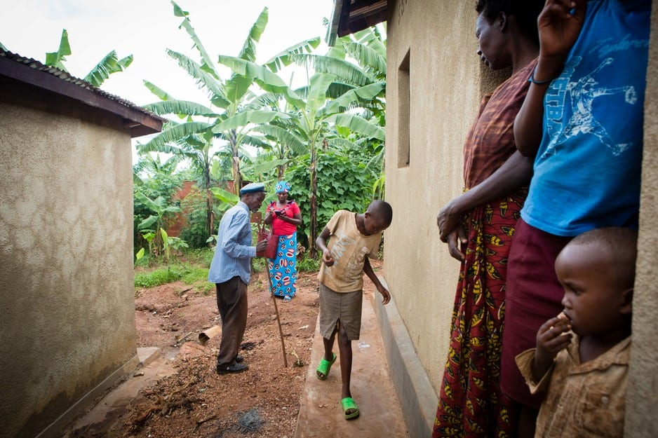 A community health worker visits a family in Rwanda