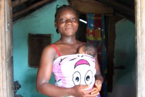 Cecile Johnson's daughter holds her daughter Sheba as part of the kangaroo mother care program