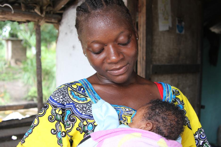 Cecile Johnson holds her daughter Sheba,