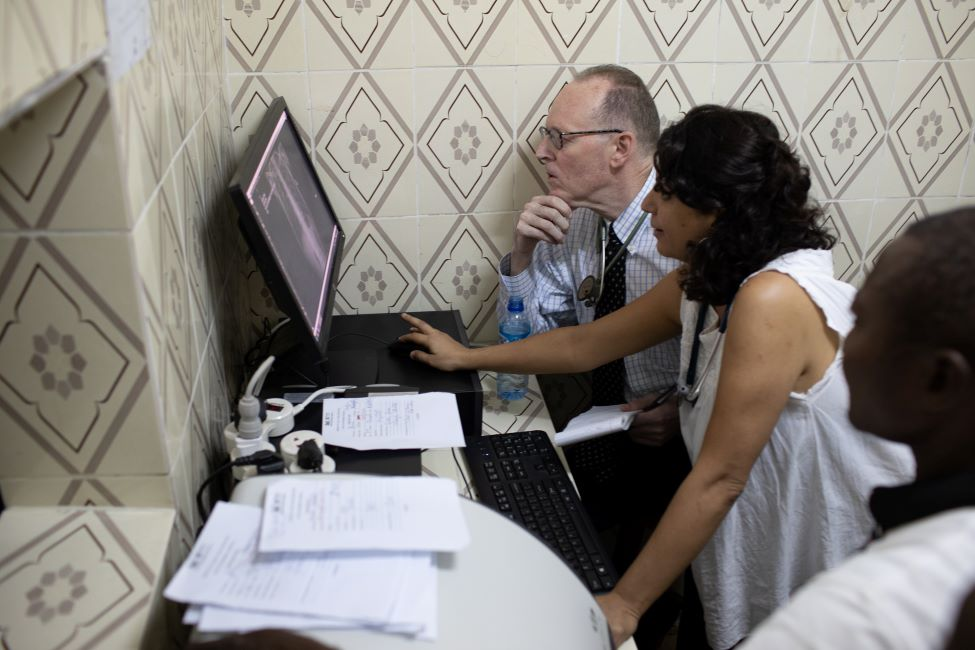 Dr. Farmer and Dr. Rodríguez look at a patient's x-rays