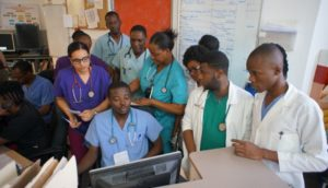 Morning shift change in the emergency department at University Hospital in Mirebalais with doctors and residents.