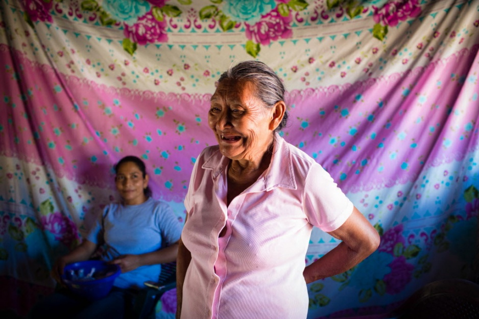 Traditional midwife Margarita Perez Jimenez stands smiling