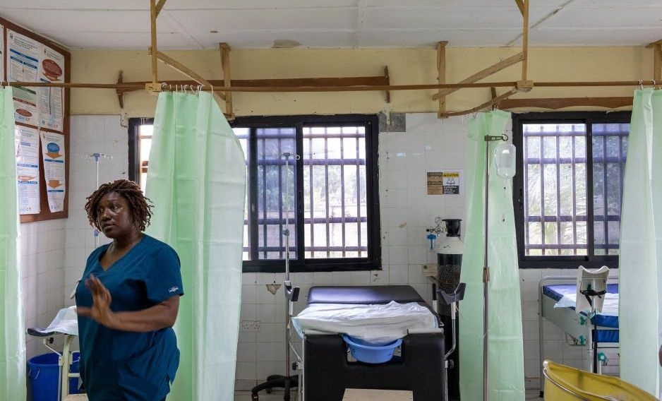 Nurse Midwife Isata Dumbuya stands in the delivery room at Koidu Government Hospital which is being supported through the Global Affairs Canada project