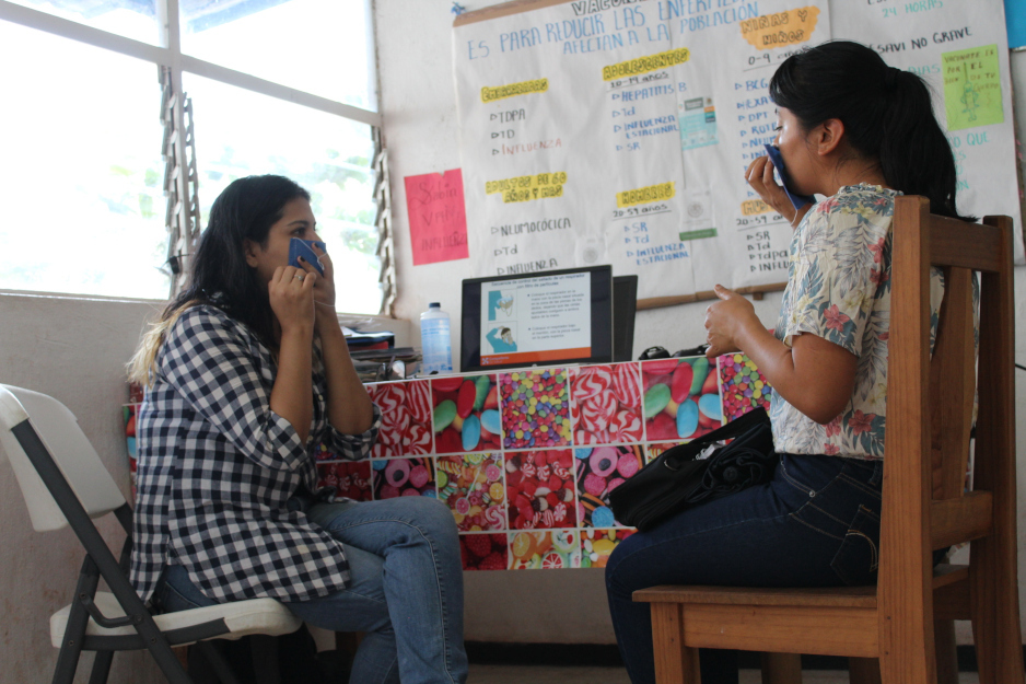 Dr. Doris Altuzar sits training a nurse as part of PIH's response to COVID-19 in Mexico