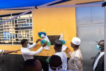 Staff and government officials celebrate the renovations at the Sierra Leone Psychiatric Teaching Hospital
