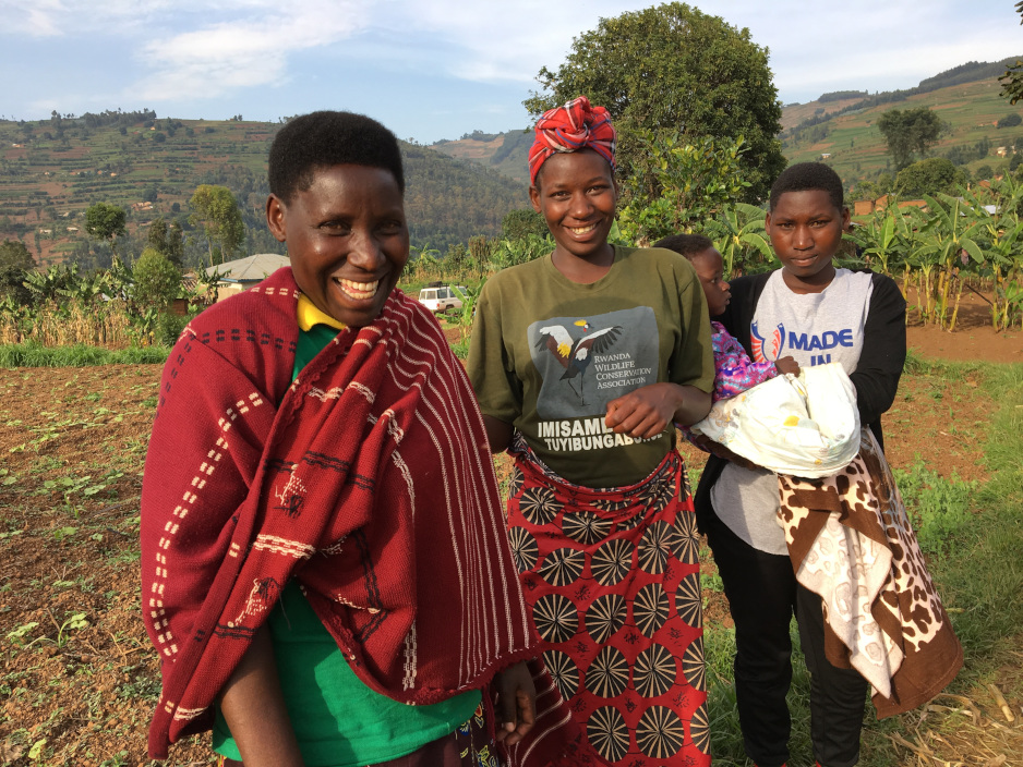 Françoise Umutesi (front), stands in March at her family's home in Butaro, Rwanda, with her eldest daughter, Pierrine Uzatuza (center), and her youngest daughter, Anitha Dukundane. Anitha is holding 1-year-old Blessing, the son of Umutesi's middle daughter, Charitine Umamwiza, not shown. Umutesi has survived breast cancer and kept all of her daughters in school with extended care and support from PIH. (Photo by Mike Lawrence/PIH)