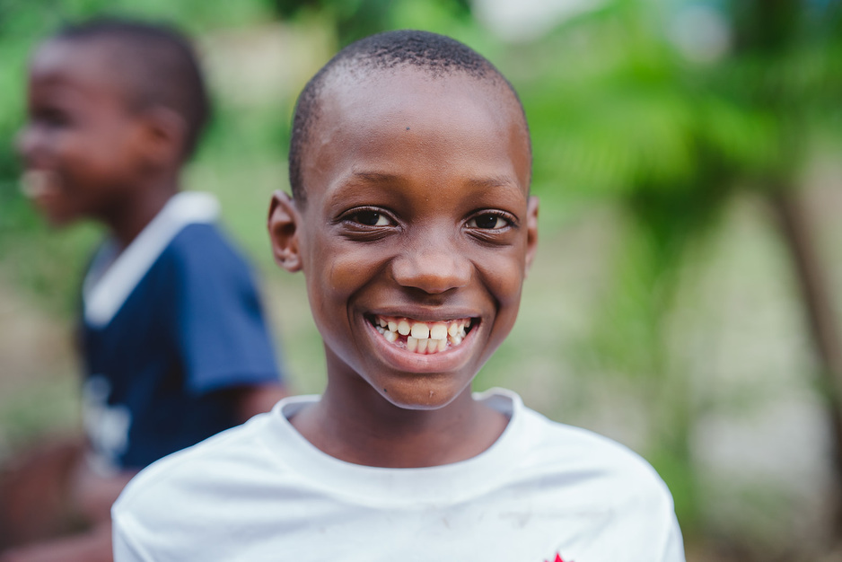 Headshot photo of student Marco Beni smiling. Marco is preparing to head back to school during COVID-19 in HaitiHaiti,
