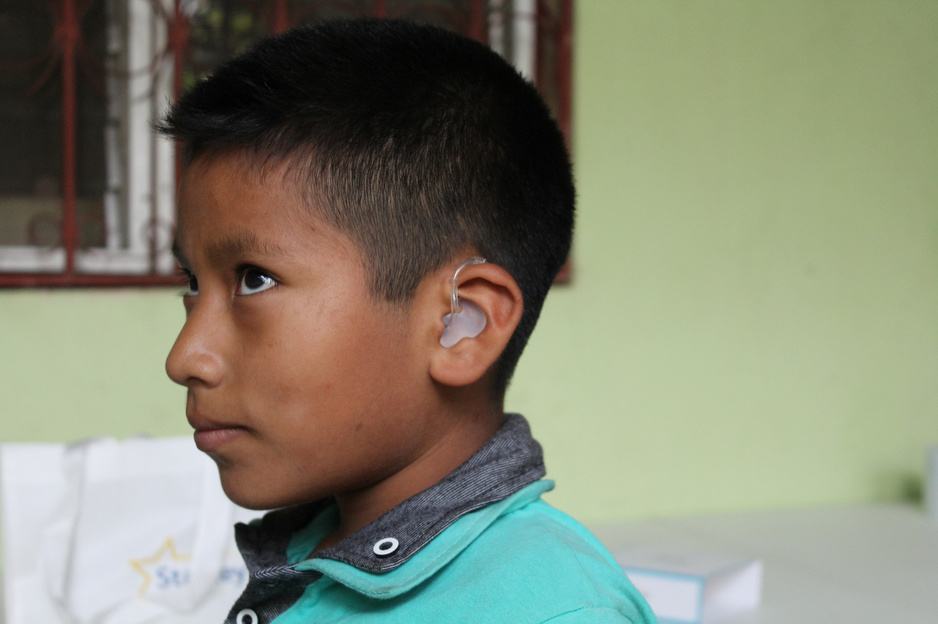 Rusbin Gómez, 9, has been hard of hearing his whole life and recently received hearing aids, thanks to support from PIH in Mexico. (Photo by Paola Rodriguez / Partners In Health)