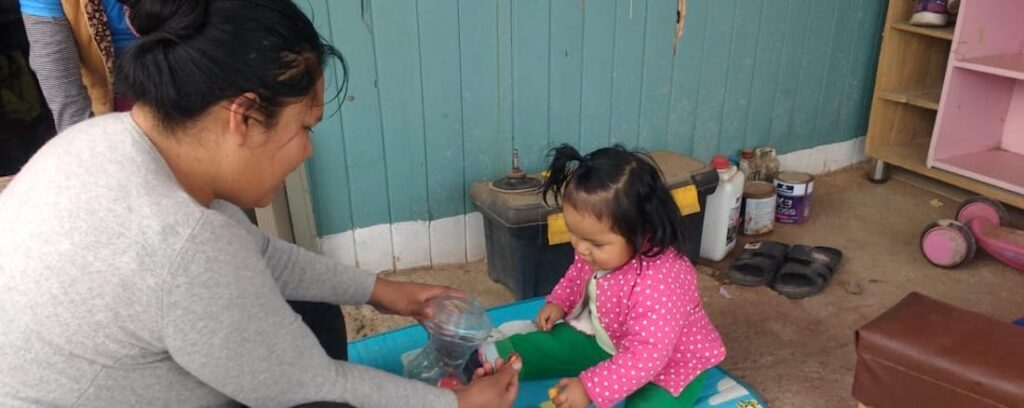 Rocío Salas and her daughter, Valentina, practice coordination skills learned through The CASITA Project focused on child development.