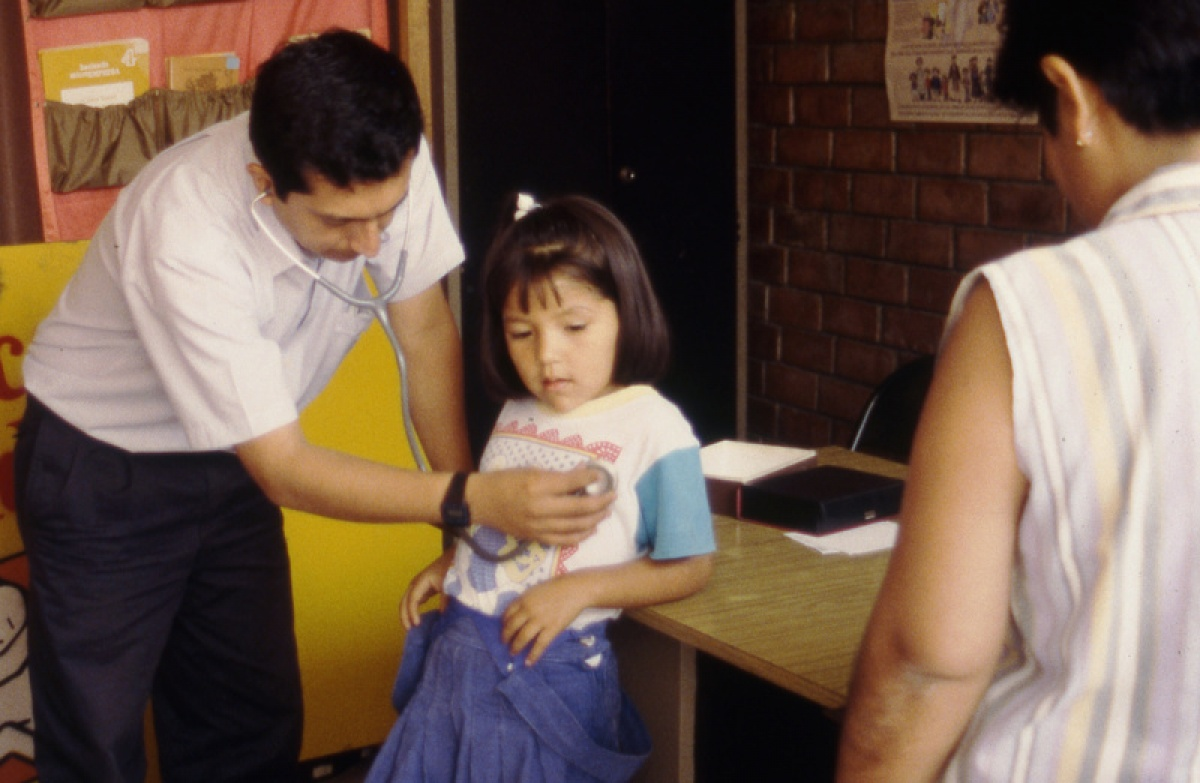 Scene from Bending the Arc documentary where Dr. Jaime Bayona provides medical care in the neighbourhood of Cristo Luz del Mundo in Carabayllo, Peru.
