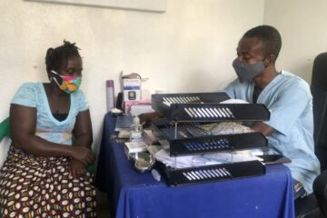 Ayumi Williams (left), a mother of two, receiving counselling from Luke Kruger Jr. (right) prior to taking her injection at the youth-friendly center at Pleebo Health Center in Maryland County, Liberia. (Photo by Marian Roberts/PIH)