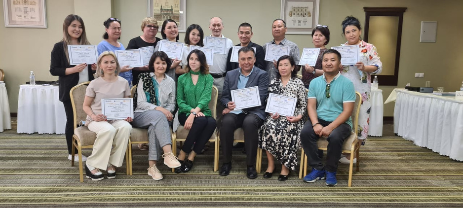 Participants in mental health training course with their certificates.